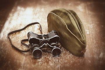 Soldier field cap, military binoculars.May 9 Victory Day