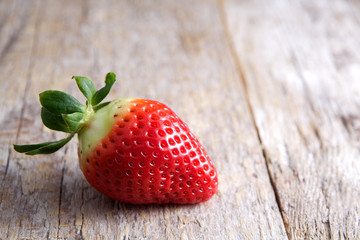 Strawberry on wood