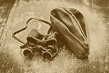 Vintage military binoculars and field cap.Victory Day 9 may