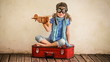 Happy kid playing with vintage airlane toy. Child having fun at
