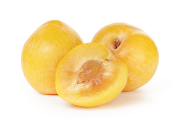 three ripe yellow plums