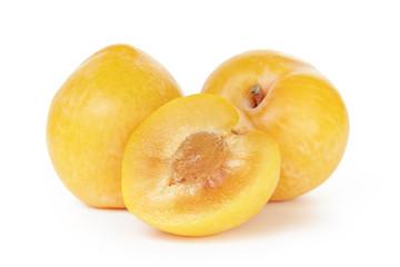 three ripe yellow plums