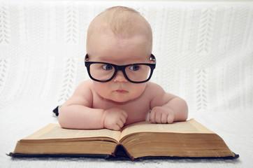 cute little baby in glasses