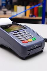 Credit card reader on desk in store