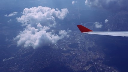 View on sky and clouds. Wing of airplane from window. HD