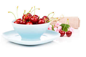 Bowl full of cherries isolated on white background