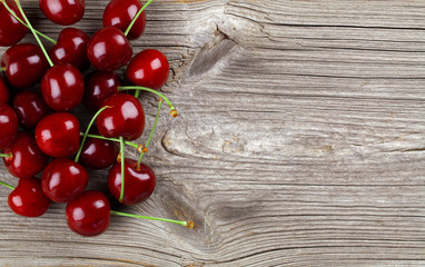 Sweet cherry on wooden background