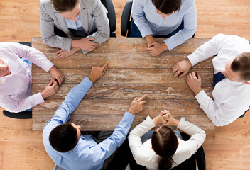 close up of business team sitting at table