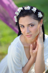 young woman with spring flowers in her hair