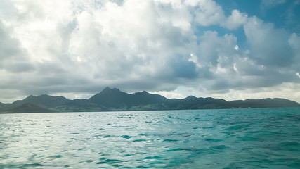 green sea with mountain landscape in mauritius