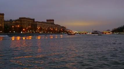 River ship, houses on a winter evening promenade