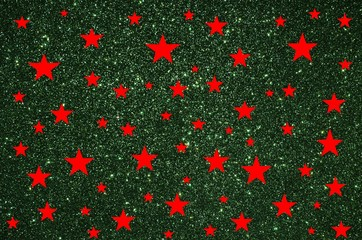 Red stars on green glitter background