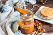 Leinwandbild Motiv peanut butter to eat a teaspoon of jars, pancakes