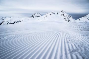 Ski slope just prepared for skiing.