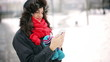 Happy woman doing selfie in the park at winter time
