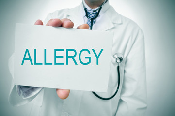 doctor showing a signboard with the word allergy