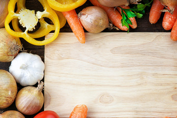 Fresh vegetables mix and wooden cutting board