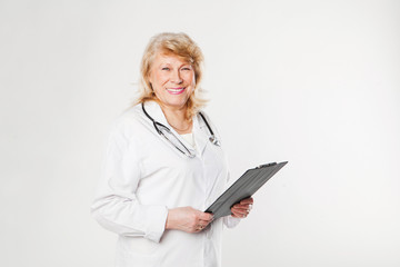 Smiling senior doctor woman with stethoscope.