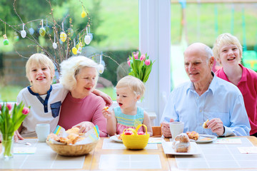 Grandparents with grandchildren enjoying Easter breakfast