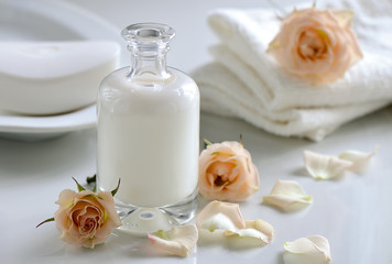Cosmetic milk, shampoo or lotion in glass bottle