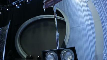 Tilt up from standing lights to lights on a studio/set