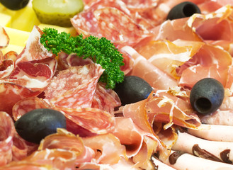 Party food with sausage slide, ham, olive, green parsley
