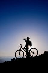 Cyclist drinking water.