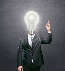 Businessman with lit light bulb as a head, idea concept