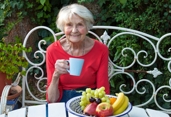 Old Woman Having a Coffee at the Garden.