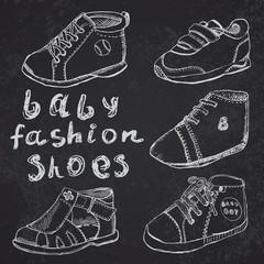Baby fashion shoes set sketch handdrawn on blackboard