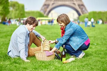 Couple having a picnic near the Eiffel tower