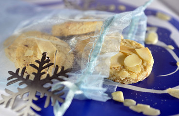 Almond cookies in a blue translucent textile bag