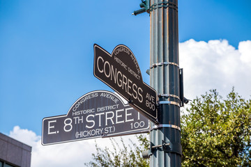 Sign at the intersection of West 8th Street and Congress Avenue
