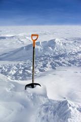 Snow shovel in snow