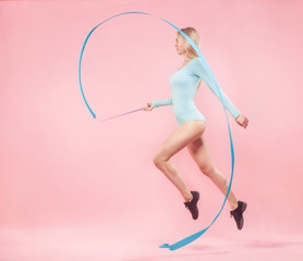 blonde woman with gymnastic ribbon