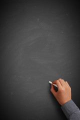 Hand writing on blank chalkboard