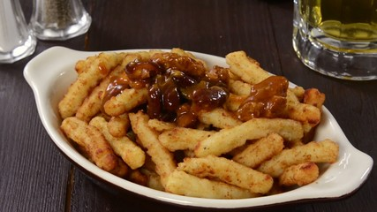 Spooning chili onto french fries