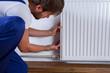 Handyman fix the radiator - 78134268