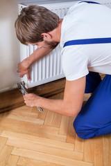 Handyman trying to fix heater