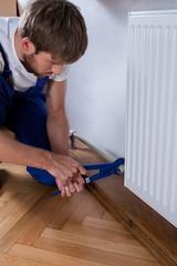Handyman during repairs radiator