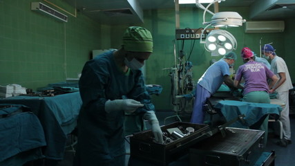 Medical team transferring the patient on table