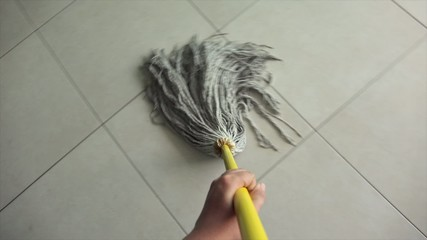 Woman Doing Chores Washing Floor At Home