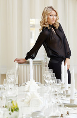 Elegant blonde posing in posh restaurant
