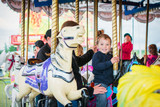 Excited Boy on a Carousel Horse