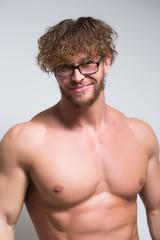 Sexy muscular male model wearing in glasses
