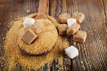 Brown cane sugar on   wooden table