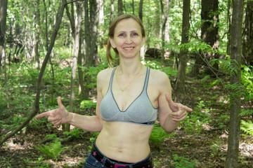Woman doing gymnastics on the nature