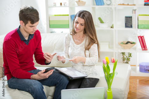 canvas print picture View of an Attractive couple doing administrative paperwork.