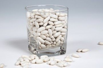 Dried white beans in a glass © Arena Photo UK