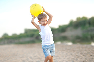 portrait of a little boy on the beach in summer